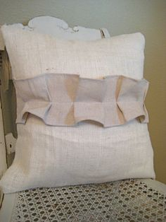 Burlap ruffle on thrift store pillows.. MAYBE ADD THREAD WHIPSTITCH TO THEM TOO!