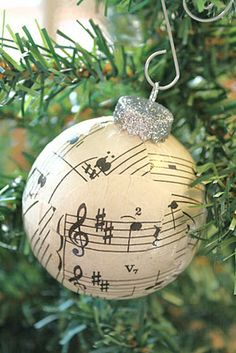 @Shivonne Tuoti: Sheet Music Ball Ornaments. It looks like she cut little circles out of the paper and then used mod podge to make them stick. Then just put glitter in the mod podge and paint it over the top piece...or something.