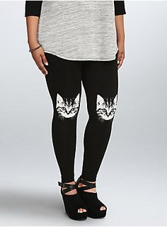 """<p>Well, the cat's out of the bag. Or more accurately, the cat is out on your knees. While these stretchy-smoothleggings may look like a solid black from the back, you'll sur-purriseeveryone with the cat head graphics on the front knees.</p>  <ul> <li>30"""" inseam</li> <li>Cotton/spandex</li> <li>Wash cold, dry flat</li> <li>Imported plus size leggings</li> </ul>"""