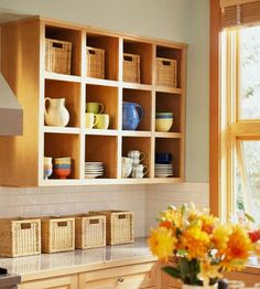 Baskets add a tidy look to these kitchen shelves and counter. Click for more ideas on storage with baskets and bins.