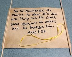 Use card stock and dowel rods to make a scroll for the scripture verse, but first make paper look old by crunching it up and dyeing it with tea bags.