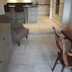Antiqued grey stone tiles have been used to create this grey stone kitchen floor - Antiqued Grey Barr limestone Click the image to read more! Stone Kitchen Floor, Stairs In Kitchen, Kitchen Tiles, Kitchen Flooring, Kitchen Grey, Room Kitchen, Kitchen Decor, Flagstone Flooring, Limestone Flooring