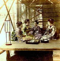 "Four Maiko Dining on ""Yuka"" Along the Bank of the Kamo River, KYOTO"