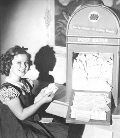 Shirley Temple with her fan-mail, 1938.