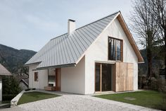 This Slovenian home by Skupaj Arhitekti mimics the gabled form of its Alpine village neighbours, but it also features contemporary details and finishes.