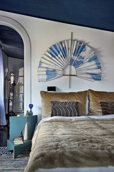blue ceiling + white walls + caramel bedding