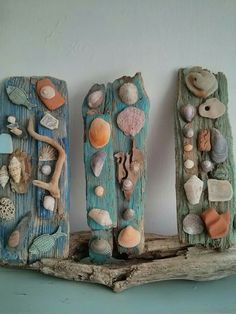 Driftwood decorated with Sea side treasures. sea side art design by Philippa Komercharo.