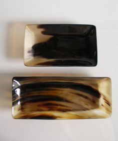 """- Handmade Horn Tray - beautiful tray with a polished finish - due to the organic nature of these pieces, each one varies in color and shape - available in two sizes: - small -- 7"""" x 4.25"""" x 1"""" high -"""