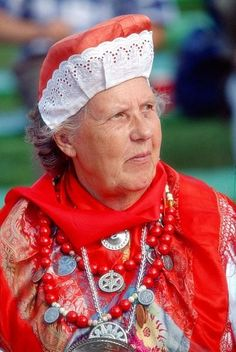 Wonder which part of Estonia the costume is from - quite red---Kihnu island?