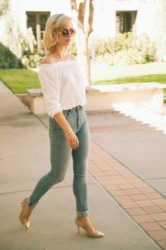 70s style off the shoulder white top and high waisted blue jeans with gold heels #chroniclesofchanel
