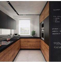 A madeira quebra a seriedade do preto, amenizando o peso que a cor pode…