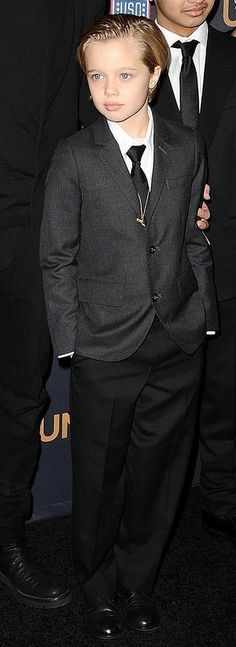 Shiloh Jolie-Pitt (8) who prefers to be called John, in suit and tie at premiere of 'Unbroken', December 2014