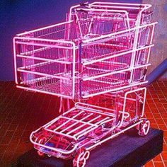 Name of work: Hot Rod Artist: Linda Dolack Dimensions: x x Medium: steel shopping cart, neon pink light The work adds a futuristic look to a seemingly ordinary object. The lights highlight the frame of the cart. Vaporwave, Filigranes Design, House Design, Instalation Art, Displays, Neon Aesthetic, Cyberpunk Aesthetic, Peach Aesthetic, Photo Wall Collage