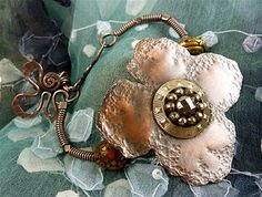 Sharilyn Miller, awesome wire & metal jewelry. Interesting blog, too