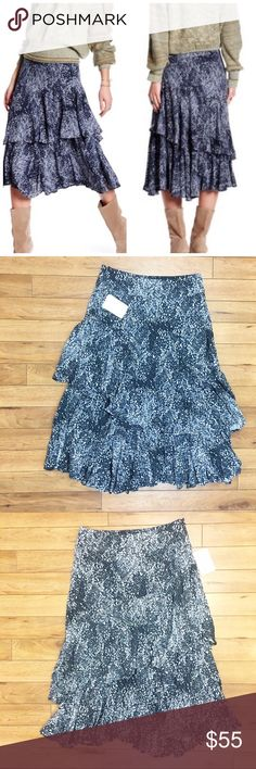"NWT FREE PEOPLE blue ruffle skirt size 4 Details: beautiful free people skirt  Size: 4 Material: in photos  Condition: NWT  Measurements are taken flat! Waist: 15.5""  Length: 31""  ☑️ Bundle Discounts  ☑️Fast shipping  ☑️Posh Ambassador  ✨Shop with Confidence Free People Skirts Midi"
