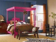 Bedroom: Blue Bedroom With Pink Bed. girl room decor. pink canopy bed. ethnic patterned bedding. zebra print rug. blue bedroom. orange curtain. wooden bedroom bench.