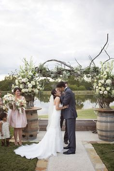 Stunning ceremony arch | Blush and Ivory Spring Wedding at Thistle Springs Ranch from Barefeet Photography » Hey Wedding Lady
