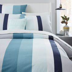 NEW! The graduated colorblock pattern on our Stepped Stripe Duvet Cover + Shams features one accent stripe in bold navy to wake up your look.