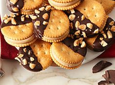 RITZ HALF MOONS Recipe (This was from a Guy Fieri show.  You could substitute the Ritz for Graham Crackers as well but would probably need to double the filling recipe.  I would probable dip the entire cracker in chocolate instead of just half of the cracker.  Then drizzle them with a contrasting chocolate.)  l  Just a Pinch
