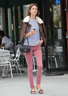 Pink pants with a striped shirt.