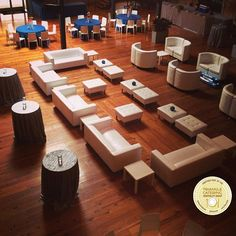 Large lounge area with white couches and ottomans at a corporate event in Durham, NC #triangleweddings
