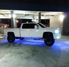 White Chevy lifted truck 4-door LED blue lights #cencaltrucks #chevypower #dopetruck