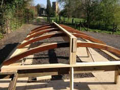 Curved Timber Roof Structure stained and part assembled