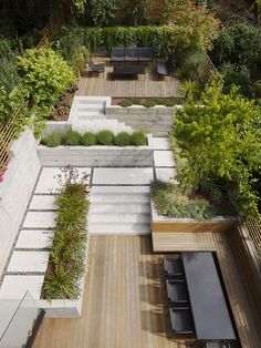 back garden patio with different hardscape and levels dining area with built in bench