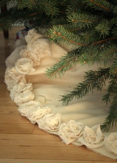 Plush Ivory Christmas Tree skirt. Trimmed with Handmade Cotton Flowers. $160.00, via Etsy.