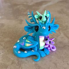 It's almost Mother's Day so you know what that means! Time for mama and baby dragons!!!  #dragonsandbeasties #mothersday #dragonsculpture #cutedragon #motherandchild #dragon #polymerclay #premosculpey #sculpey #rainbow #claydragon