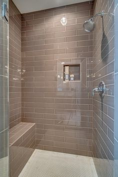 4x16 Subway Tiled Master Shower With Accent Strip Design