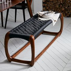 I love this John Vogel Bench from West Elm. Maybe at the foot of the bed, or in the entry?