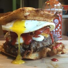 No filter needed for this up close and personal Sriracha Egg & Cheddar Waffle Burger!  Just look at that gentle incision leading to a successful yolk transfusion  Be on the lookout for the next post for a beautiful presentation of this tasty creation   FlexibleDietingLifestyle.com  #flexibledietinglifestyle #ifitfitsyourlifestyle
