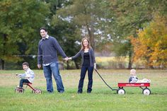 awesome family pose,  fall family photo shoot ideas,  radio flyer wagon photo shoot  www.HelenJohnPhotography.com
