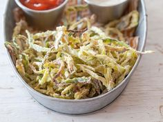 Baked Zucchini Shoestring Fries : Toss spiralized zucchini with a beaten egg, then dredge in seasoned flour and bake at 350 degrees F for about 20 minutes until brown and crispy.