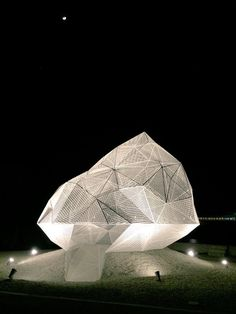 sou fujimoto's geometric naoshima pavilion. seven meter polyhedron, constructed using a white stainless steel mesh
