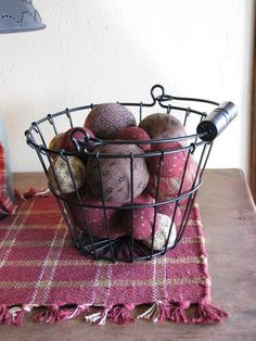 Use this adorable black wire basket at the Quilt Shop to store and display things in your home! It's perfect for complimenting the decor in any room! https://www.primitivestarquiltshop.com/collections/farmhouse-primitives/products/black-wire-basket