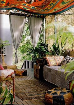 Plants. rugs, textiles... Love it all! Such a cozy place.