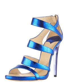 """Jimmy Choo  Crushed Metallic Sandal  Step brightly in this bright metallic Jimmy Choo sandal.  Crushed metallic leather forms curvaceous, asymmetric straps.  Back zip with logo-engraved pull tab.  4 3/4"""" mirrored leather covered heel.  """"Gretchen"""" is made in Italy."""
