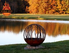 """Winter Woods. 37"""" Custom Steel fire pit.  The Winter Woods peaceful birch tree fire pit sphere seems to draw you in, as though you are standing in a quiet forest sanctuary. Designed by Artist Melissa Crisp of The Fire Pit Gallery. Can use the DYO (Design Your Own Option and add an animal or couple holding hands."""
