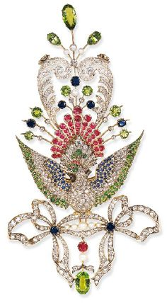 AN UNUSUAL ANTIQUE DIAMOND AND GEM-SET PEACOCK BROOCH   Centering upon an old European-cut diamond peacock, with pavé-set demantoid garnet head, enhanced by circular-cut ruby crest, and cabochon ruby accent eye...circa 1890