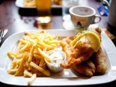 Chow down on a hearty meal of fish and chips in London, and douse it with malt vinegar — as the locals do.