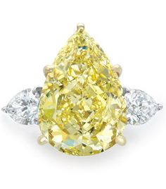 Fancy 13.3 Carat Yellow Diamond and Diamond Ring