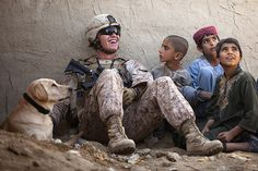 LCpl Isaiah Schult, USMC, 20, and his dog look for improvised explosive devices in Afghan. But they also befriend the kids---uplifting