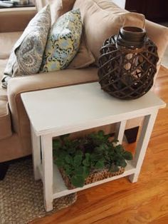 Narrow side table with light distressing. I made this to fit perfectly to the arm of the couch. Total cost was about $10.