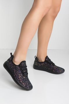Light as a cloud, sparkly as a star. The Keep It Unreal Lightweight Glitter Sneakers are for working it, not working out, with a flat ridged sole to keep you gripped, stretchy slip-on mesh uppers, adjustable laces, pull-on tabs at the heels, and glitter a