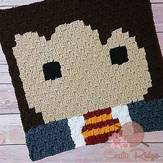 Hermione is the 4th square for the Crafty Ridge Harry Potter CAL! Hop over to the blog for the FREE pattern and some tips and how to's on c2c graphs #craftyridge #crochet #crochetaddict #yarnaddict #fiberart #harrypottercal #harrypotter #hermionegranger #hermione #redheartyarn #tutorial