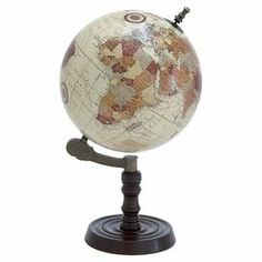 "Add a stately touch to your library or living room with this antiqued globe, showcasing a turned base and medieval mariners' routes.    Product: GlobeConstruction Material: Metal and woodColor: Espresso and multiFeatures: Medieval map of the worldDimensions: 21"" H x 14"" Diameter"