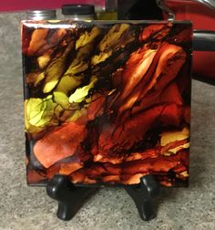 Alcohol ink on tile coaster.