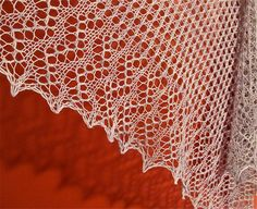 Elegant and ethereal, this is a quick, relatively simple top-down triangular shawl that begins with the same four row pattern repeat until the edging. This is a great shawl for a beginning lace knitter, (or a more experienced lace knitter who wants something simple to knit that doesn't involve a lot of concentration!)….Only the bottom edge is charted AND written. This can be extended for a slightly larger shawl by repeating the edge chart.